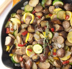 Sizzling Sausage and Potato Summer Vegetable Skillet full of healthy, delicious in-season goodness. This is an easy, fresh side dish recipe or dinner idea!