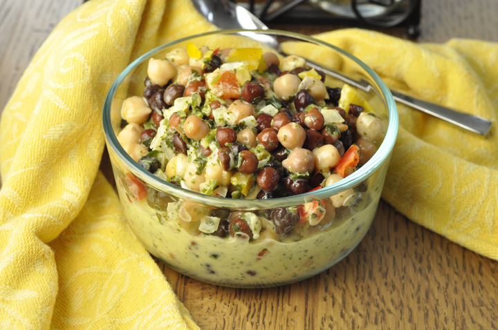 Gluten Free Summer Chickpea Black Bean Salad recipe that is low in fat and high in protein and makes an amazing side dish for your summer picnics or BBQ! You could also serve this alone or pair it with a toasted baguette or bread to make a great appetizer for Memorial Day..
