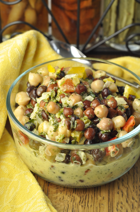 Summer Chickpea Black Bean Salad recipe that is low in fat and high in protein and makes an amazing side dish for your summer picnics or BBQ! You could also serve this alone or pair it with a toasted baguette or bread to make a great appetizer or snack.