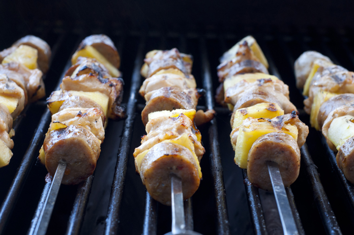 Grilling Hawaiian Pineapple Chicken Kabobs on Weber Grill in the summer.