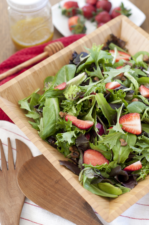 Strawberry Arugula Salad with Honey Lime Vinaigrette recipe is a healthy green salad loaded with fresh fruit and nuts. It is great for picnics and really captures the essence of summer!