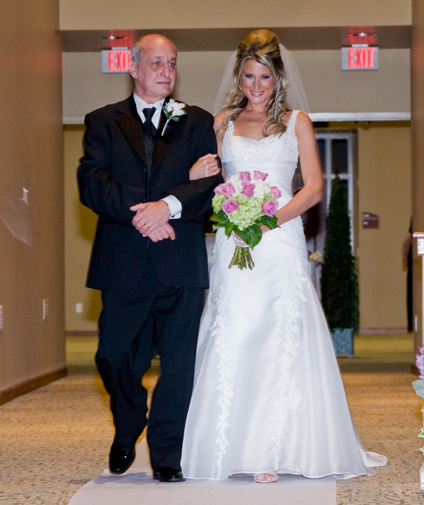 Picture of me walking down the aisle at my wedding with my dad.