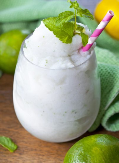 """Frozen Coconut Mojito drink recipe, or """"Cocojito"""", is an icy taste of summer that is laced with coconut and has the traditional lime and mint flavors we all love in a good Mojito!"""