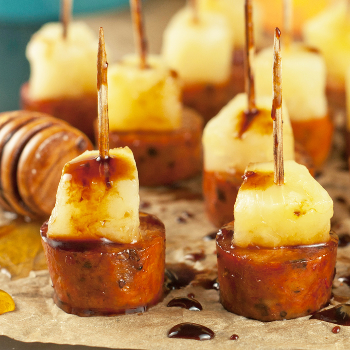 Glazed Chicken Sausage Pineapple Bites are a a simple sweet & salty snack recipe to throw together at the last minute and make for a great party, holiday or game day appetizer!