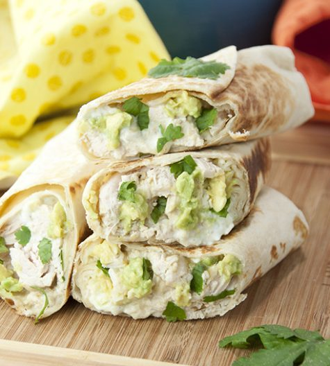 Chicken and Avocado Burritos recipe are stuffed with gooey melted cheese, Greek yogurt, juicy chicken, creamy avocado, and salsa verde for an easy weeknight, kid-approved dinner!