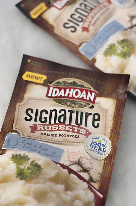 Idahoan Signature Russets Mashed Potatoes are perfect as a side dish to any main course. They are so buttery, creamy and take five minutes to make!