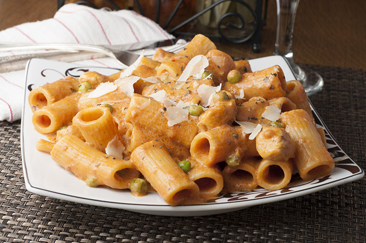 Spicy Chicken Rigatoni recipe, also known as Chicken Riggies, is a copy-cat pasta dish from Italian-American restaurant Buca di Beppo. Creamy Alfredo and marinara sauce combine with chicken and peas to make the perfect, easy Italian meal with the perfect amount of spice!