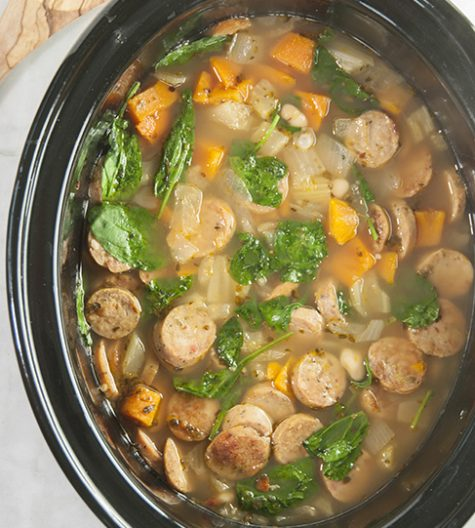 Crock Pot Sausage, Spinach & White Bean Soup is light, healthy, gluten free, and made right in your slow cooker. This is made with chicken sausage and is the perfect lunch or dinner for the cooler weather!