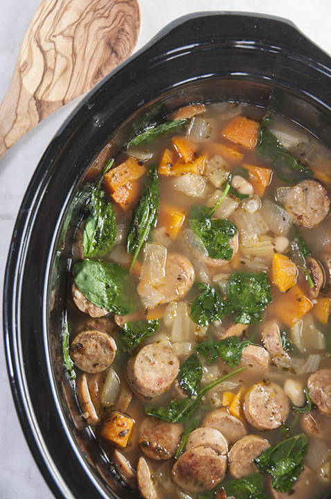Crock Pot Sausage, Spinach & White Bean Soup is healthy, gluten free, that cooks right in your slow cooker. This is made with chicken sausage and is an easy lunch, pot luck meal, or dinner for fall or winter.
