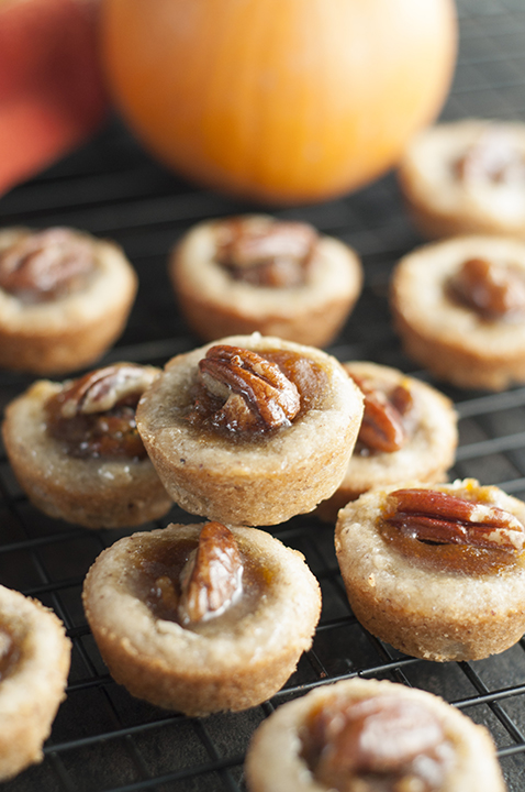 Mini Pecan Pumpkin Pies dessert recipe is all that is wonderful about the holidays rolled into one bite size treat! No need to choose between pumpkin pie or pecan pie anymore!