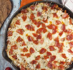One Pan Pizza Pasta Casserole is an easy, family-friendly, crowd-pleasing recipe that combines two favorites into one! It is all made in one pot for a comforting weeknight meal with fast clean up!