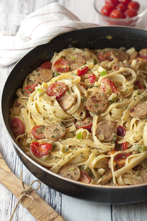 One Pan Sausage Pepper Fettuccine Skillet is an easy weeknight dinner pasta recipe made lightened up with chicken sausage and sure to impress your entire family or company!