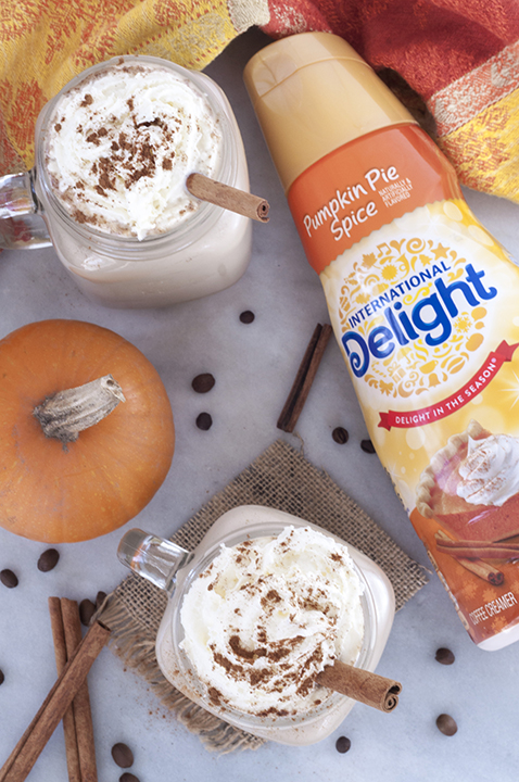 Easy Slow Cooker Pumpkin Spice Lattes meant for a crowd is the perfect recipe to serve at a fall holiday party! It would also be great for a potluck, Halloween, Christmas or Thanksgiving.