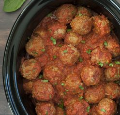 Quick and Easy Slow Cooker/Crock Pot Italian Meatballs packed with Parmesan cheese, fresh parsley and garlic in a delicious marinara sauce! They work well for dinner served over pasta, a holiday party or a potluck!