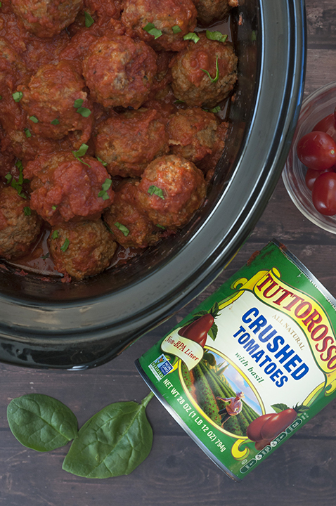 Quick and Easy Slow Cooker or Crock Pot Italian Meatballs packed with Parmesan cheese, fresh parsley and garlic in a delicious marinara sauce! They work well for dinner served over pasta, a holiday appetizer or a potluck dish to pass!