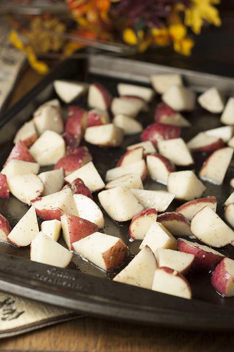 Roasting the potatoes in the oven for a side dish.