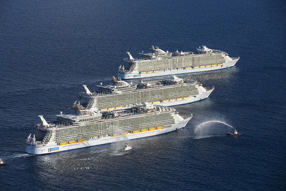 Three sister ships: Royal Caribbean Harmony of the Seas, Allure of the Seas, and Oasis of the seas together at sea.