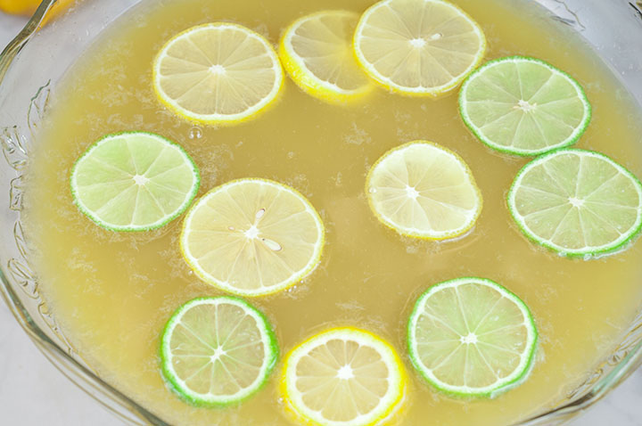 This easy, all season Lemon-Lime Champagne Party Punch recipe will be a hit at any holiday party, bridal or baby shower, and New Year's Eve! Kid-friendly, non-alcoholic version included!