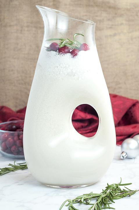 Creamy White Christmas Coconut Margarita Punch recipe for a holiday party to please a crowd!