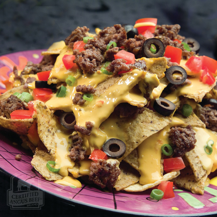 This recipe for Cheesy Loaded Beefy Nachos is an easy last-minute appetizer to throw together for your game day parties! These simple nachos will disappear in no time at all!