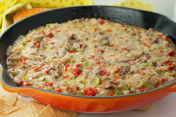 Philly Cheesesteak Dip recipe is made with shaved roast beef, colorful peppers, and loads of ooey gooey cheese. Perfect for Super Bowl, holiday party, or an appetizer to serve at a pot luck!
