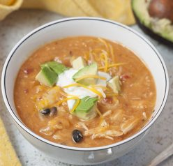 Flavorful and hearty 20 Minute Cheesy Chicken Enchilada Soup recipe is incredibly easy to cook up and full of the BEST flavors. Serve it with tacos and guacamole for Taco Tuesday!