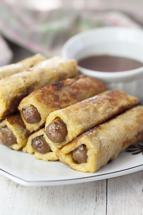 This sweet and savory recipe for Mini French Toast Sausage Roll-Ups served with warm maple syrup for dunking will be the best addition to your Easter or holiday breakfast, brunch, and
