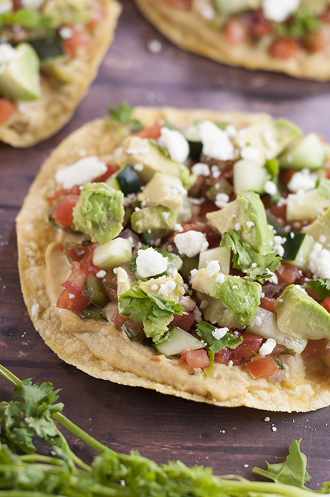 Vegan Pine Nut Hummus Pico de Gallo Tostadas recipe topped with fresh Pico de Gallo and a plethora of toppings for a healthy, vegetarian appetizer, snack, or dinner!