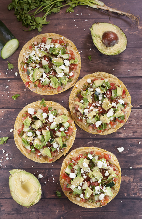 Pine Nut Hummus Pico de Gallo Tostadas recipe topped with an easy, fresh Pico de Gallo and a variety of toppings for a healthy, vegetarian appetizer or snack!