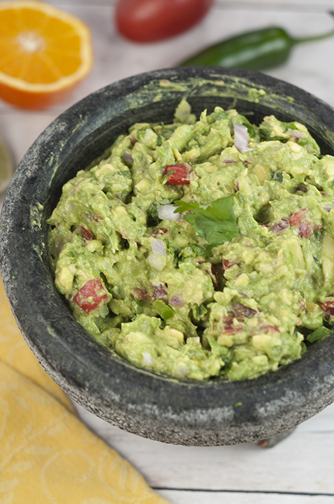 Cinco de Mayo is coming and I'm showing you how to make the best Homemade Ultimate Guacamole recipe that you'll ever have! I learned how to make it using fresh orange juice from a restaurant in San Antonio.