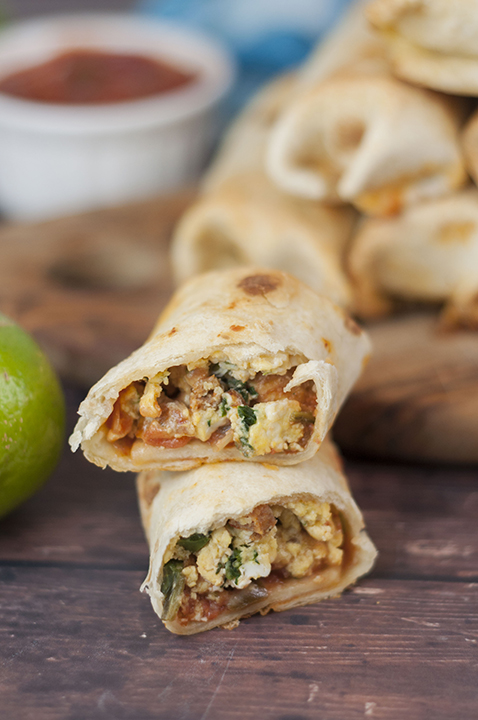"""Baked Sausage, Spinach and Egg Breakfast Taquitos are crispy, cheesy, and the perfect easy recipe for a grab-and-go breakfast or """"brinner""""!"""