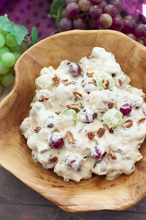 You're just 7 ingredients away from this Creamy Pecan Crunch Grape Salad recipe. It is guaranteed to be a huge hit at office potlucks, Memorial Day, BBQ's, holiday dinners and parties!