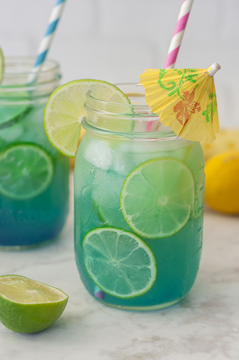 Easy Mermaid Water Rum Punch Cocktail will make you feel like you're on a tropical island and the perfect alcoholic drink for a hot summer day. Multiply the ingredients to make a big batch for your next party or BBQ!