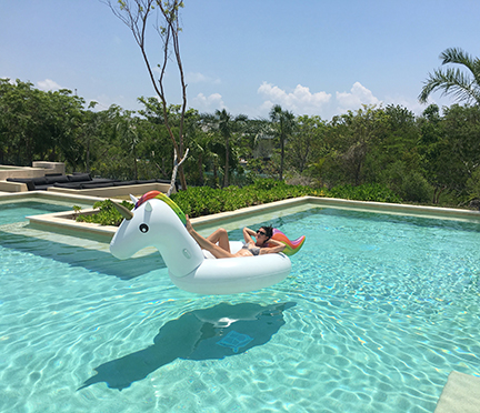 Floating in the pool on the lagoon side. Andaz Mayakoba.