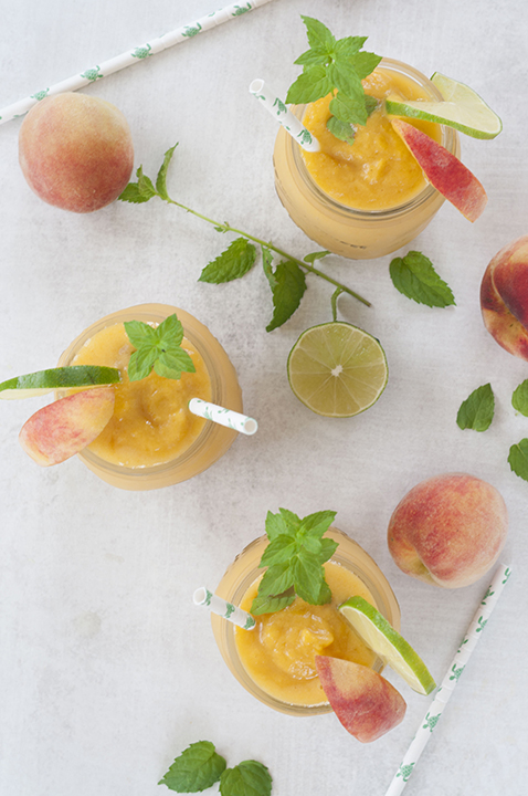 This Alcoholic Frozen Peach Mojito drink recipe is the perfect frozen cocktail on a hot day or for any occasion! These beauties are refreshing, light, and so easy to make.