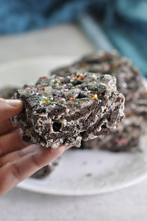 "Gooey Oreo Krispie Treats dessert recipe, or ""Cookies and Cream Bars"", is your favorite childhood treat loaded with chunks of Oreo and only 3 ingredients!"