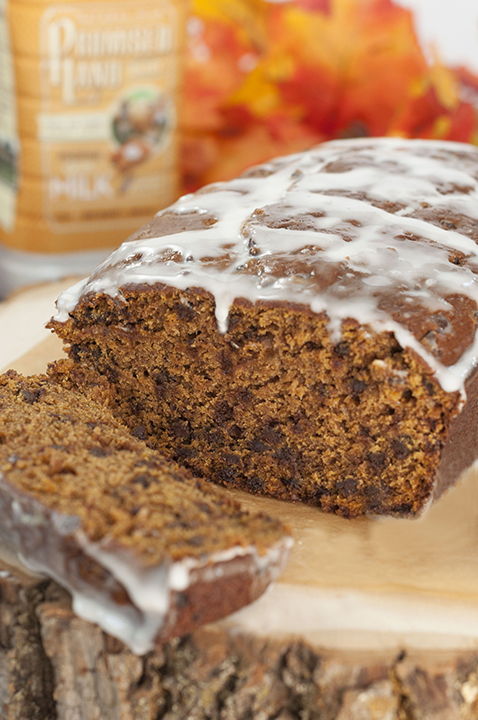 Bourban-Glazed Chocolate Chip Pumpkin Bread recipe where cinnamon and fall spices blendwith chocolate and pumpkin flavorsto make the most tender, moist holiday quickbread you'll ever make!