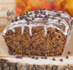 Bourban-Glazed Chocolate Chip Pumpkin Bread recipe where cinnamon and fall spices blend with chocolate and pumpkin flavors to make the most tender, moist dessert bread you'll ever taste!