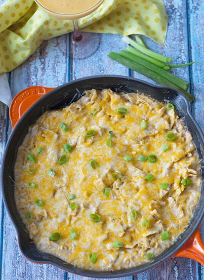 One Pan Sour Cream Chicken Enchilada Skillet recipe made quick and easy in a skillet with corn tortillas pieces, cooked chicken, and a cheesy sauce!