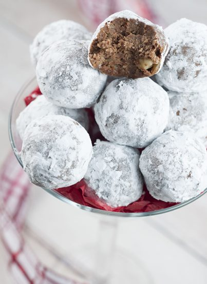 Easy Holiday Christmas Rum Balls are sweet, dense, and the perfect addition to your holiday dessert trays! This traditional recipe will have all of the adults raving!