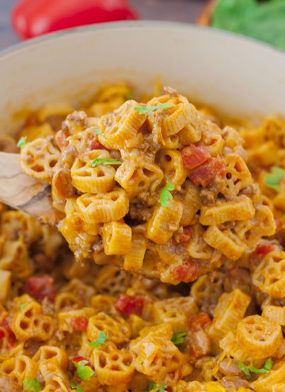 Easy One Pot Chili Mac and Cheese combines two of my favorite foods: mac 'n cheese and chili. You get the best of both worlds with this hearty dinner with gooey cheese that takes less than a half hour to make!
