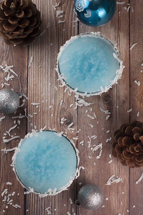 Blue Christmas Coconut Cocktail recipe is the best Christmas alcoholic drink and is sure to put a smile on everyone's faces! This is perfect for serving at a party and you can make a large batch!