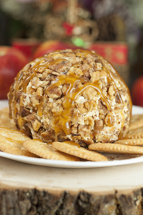 Quick and easy Caramel Apple Cheese Ball recipe works for a holiday appetizer idea, snack OR fall dessert! This sweet and salty treat would be perfect for a, office potluck or New Year's Eve party.