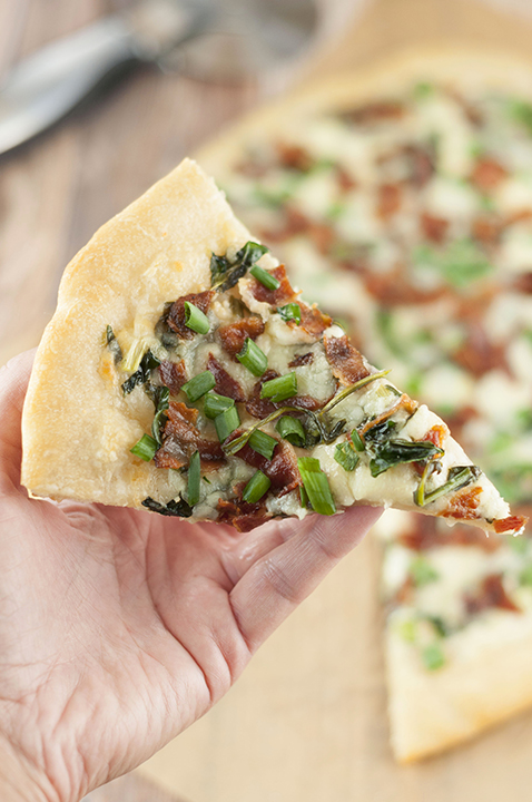 Add some excitement to pizza night with this easy Bacon Alfredo Pizza recipe! Alfredo sauce lovers will go crazy for this and each slice of this white pizza is packed with delicious pizza toppings!