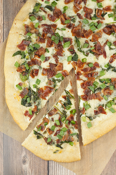 Add some excitement to pizza night with this easy Bacon Alfredo Pizza recipe! Alfredo sauce lovers will go crazy for this and each slice is packed with all your favorite toppings!