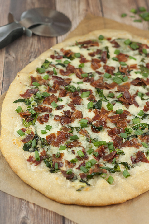 Add some excitement to pizza night with this easy Bacon Alfredo Pizza recipe! Alfredo sauce lovers will go crazy for this and each slice of this white pizza is packed with all your favorite toppings!
