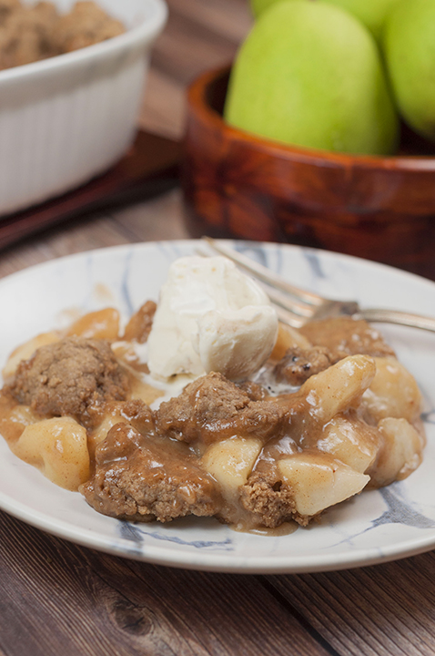 Easy Fall Holiday-Spiced Pear Cobbler recipe made with fresh pears has all of the fall/winter spices to make this the perfect, decadent holiday dessert idea!