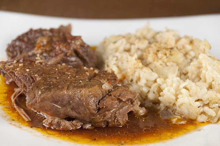 Tender, fall-apart, juicy Slow Cooker Italian Pot Roast recipe is packed with flavor and an easy weeknight dinner. It's fancy enough to serve to dinner guests for a holiday meal and the crock pot does all the work!