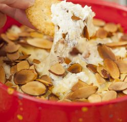 Toasted Almond Cheese Dip recipe is a quick and easy dip recipe for the holidays or game day appetizer idea! Who doesn't love a hot, creamy cheese dip topped with crunchy sliced almonds?