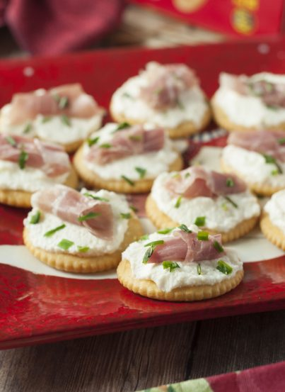 Whipped Ricotta Prosciutto Cracker Bites are the perfect Christmas appetizer recipe or New Year's Eve appetizer that comes together in no time at all and is so easy to make!